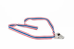 Metal whistle. Inserted with thai flag like flat rope Royalty Free Stock Images