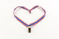Metal Whistle and ribbon striped flag of thailand. Stock Photography