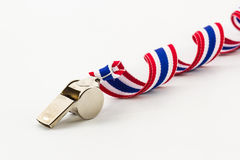 Metal Whistle and ribbon striped flag of thailand. Stock Photo