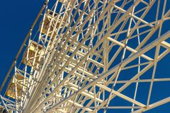 Metal white frame of a ferris wheel on a blue sky background. Ab. Stractive fragment of architecture stock photography