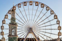 Metal white frame of a ferris wheel on a blue sky background. Ab. Stractive fragment of architecture stock photo