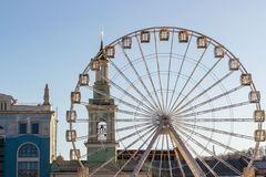 Metal white frame of a ferris wheel on a blue sky background. Ab royalty free stock photo