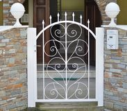 Metal gate of private house. Metal white gate of private house stock images