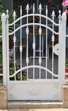 Metal gate of private house stock image