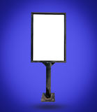 Metal white notice board. On blue background Stock Photos