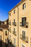Window balconies with potted plants at Cathedral Square, Girona royalty free stock image