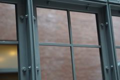 Metal Window With Brick Wall in Background Stock Photography
