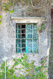 Metal window frame on a old house. Nobody royalty free stock photo