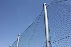 Metal wire fence with blue sky Royalty Free Stock Images
