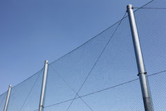 Metal wire fence with blue sky Royalty Free Stock Image