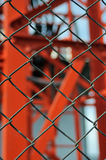 Metal wire fence or cage on abstract blurry background (selectiv Royalty Free Stock Images