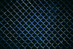 Metal wire fence or cage with blur background. Stock Image