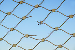 Metal wire fence protection chainlink background. Hole Royalty Free Stock Photos