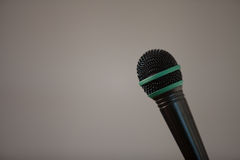Metal wire mesh black microphone on a gray background Stock Photo
