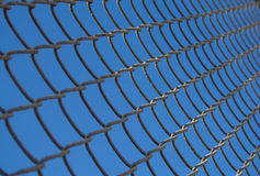Metal wire mesh in blue sky. Close up of metal wire mesh in blue sky Stock Image