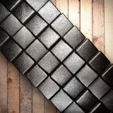 Metal on wood background. Made in 3d Royalty Free Stock Image