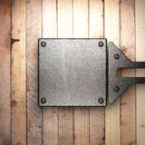 Metal on wood background. Made in 3D Stock Photography