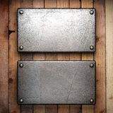 Metal on wood background Royalty Free Stock Photography