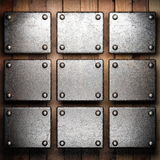 Metal on wood background. Made in 3d Royalty Free Stock Photos