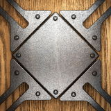Metal on wood background. Made in 3d Stock Photo