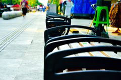 Rows of wood and metal chair on the open air shopping street in South East Asia royalty free stock photo