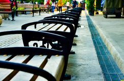 Rows of wood and metal chair on the open air shopping street in South East Asia stock photo