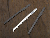 Metal and wood jigsaw blades Royalty Free Stock Photography