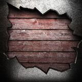 Metal on wooden wall Royalty Free Stock Photography