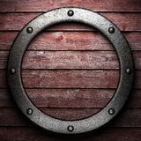 Metal on wooden wall Stock Photos