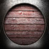 Metal on wooden wall Royalty Free Stock Photos