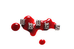 Metal Word drugs in drops of blood Royalty Free Stock Photo