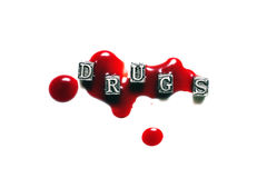 Metal Word drugs in drops of blood Royalty Free Stock Images