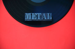 Metal word on vinyl record Royalty Free Stock Images