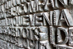 Metal Words Background on Sagrada Familia Door, Barcelona, Spain Stock Photography