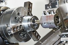 Metal work by bore machining on lathe royalty free stock photo