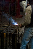 Metal Worker. A metal worker working in a factory stock photography