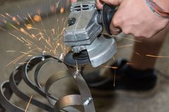 Metal worker with angle grinder - sparking stock image