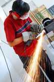 Metal worker with grinder. Metal worker with  a grinder Royalty Free Stock Image