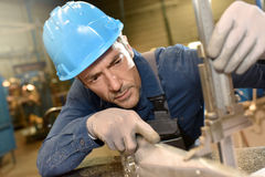 Metal worker using machines Stock Images
