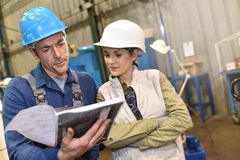 Metal workers discussing work Royalty Free Stock Photos