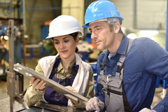 Metal workers at workshop Royalty Free Stock Photo