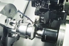 Metal working. cutting tool pefroming turning operation at cnc machine Stock Photos
