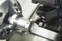 Metal working. cutting tool pefroming turning operation at cnc machine Royalty Free Stock Images