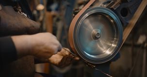 Metal working industry. Finishing metal surface on grinding machine. royalty free stock photo