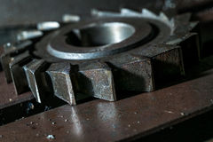 Metal working. Process of tooth gear wheel finish machining by cutter tool at factory Royalty Free Stock Image