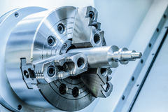 Metal workpiece clamped in the lathe chuck CNC machine Stock Photo