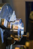 Metal workpiece clamped in the lathe chuck CNC machine Stock Images