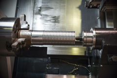Metal workpiece clamped in the lathe chuck CNC machine Royalty Free Stock Photo
