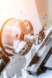 Metal workpiece clamped in the lathe chuck CNC machine Stock Photos