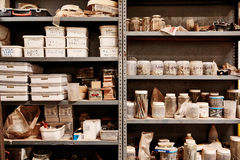 Metal workshop shelves with variety of containers arranged neatl Stock Images